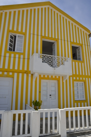 yelow: Traditional beach house in yelow coloured stripes in Costa Nova, Portugal. These traditional structures were used by fishermen to store their fishing materials and have also been used as beach houses throughout the years.