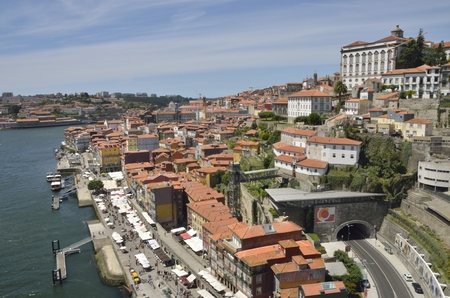 ribeira: Ribeira district alog the Douro river seen from the top of Dom Luis bridge in Porto, Portugal. Editorial