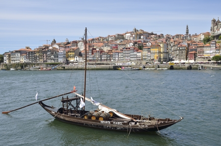 rabelo: Rabelo boat, used to transport Port Wine, on the Douro river with views to the Ribeira in Porto, Portugal