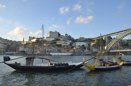 rabelo: Rabelo boats, used to transport Port Wine, on the Douro river next to Dom Luis bridge in Porto, Portugal