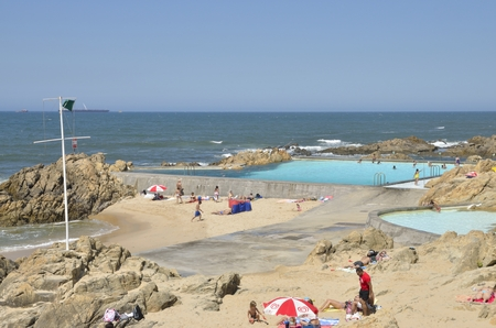 lea: People sunbathing  at the  the beach of Le�a da Palmeira which is located north of the city of Matosinhos, in the district of Porto, Portugal. Editorial