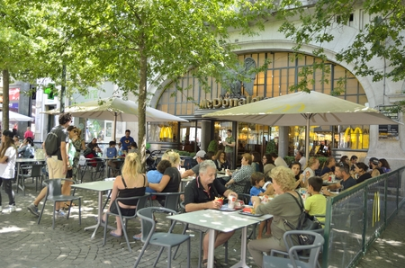 mc: People eating outdoor of a Mc Donalds restaurant in Aliados Avenue Porto, Portugal. Editorial