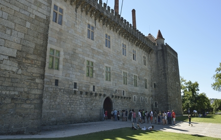 guimaraes: People in a queue to get into  the Palace of the Dukes of Braganza of Guimaraes,   in the northern region of Portugal. Editorial