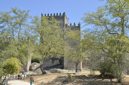 guimaraes: People in the path to the Castle of Guimaraes,   in the northern region of Portugal. It was built at the end of the 13th century, following French influences.