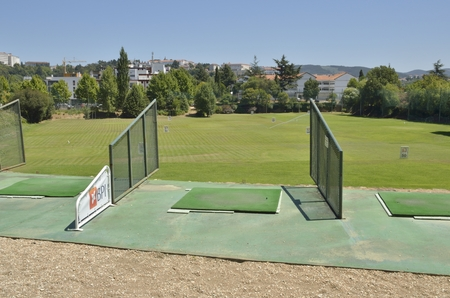 quinta: Practice golf course  in the gardens of Quinta das Lagrimas with views to the city in Coimbra, Portugal