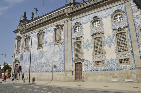 carmo: People in front of the tile facade of Carmo church in Porto, Portugal Editorial