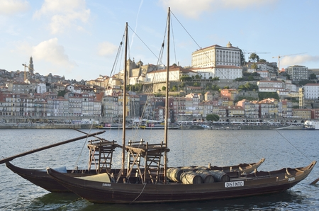 rabelo: Rabelo boat, used to transport Port Wine, on the Douro river next to Dom Luis bridge in Porto, Portugal