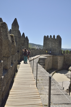guimaraes: People at the top of the Castle of Guimaraes,   in the northern region of Portugal. It was built at the end of the 13th century, following French influences.