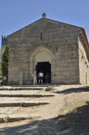 guimaraes: People going into the Church of Saint Miguel do Castelo, a romanesque church constructed within the circle of the Castle of Guimaraes, Portugal. Editorial