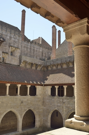 guimaraes: Courtyard of the  Palace of the Dukes of Braganza seen from the upper gallery in Guimaraes,   in the northern region of Portugal. Editorial