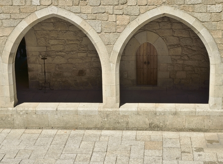 arcos de piedra: Stone arches of the corridor at the inner patio of  Palace of the Dukes of Braganza in Guimaraes,   in the northern region of Portugal.