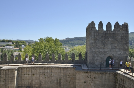 guimaraes: People at the top of the Castle  with views of the city in the background,   in Guimaraes, Portugal. Editorial