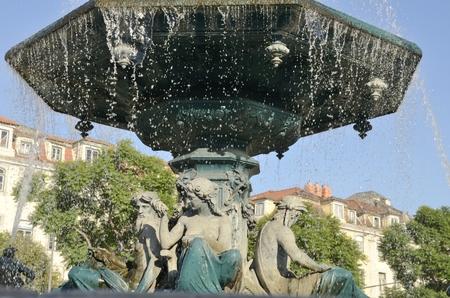 Sculptures at baroroque fountain in Rossio Square, Lisbon, Portugal
