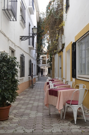 Tables at a street of the historic center of Marbella, a city of the province of Malaga, Andalusia, Spain.