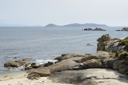 Islets at the Ria of Arosa seen from San Vicente del Mar in the province of Pontevedra, Galicia, Spain.