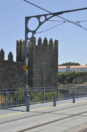 Historical tower  next to the Dom Luiz Bridge in Porto, Portugal