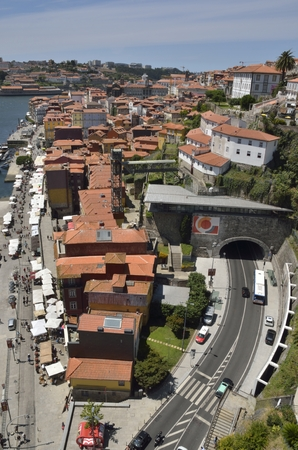 Aerial view of Ribeira Square and the surrounding district seen from the top of Dom Luiz bridge in Porto, Portugal Reklamní fotografie - 81983899