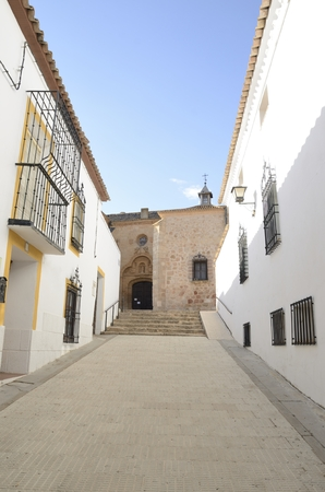 Church at the end of white street in Belmonte, a village located in the province of Cuenca, Castile-La Mancha, Spain. Stock Photo