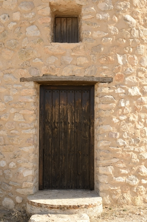 Wooden door on stone windmill  in  Belmonte, a village of the province of Cuenca, Castile-La Mancha, Spain. Stock Photo