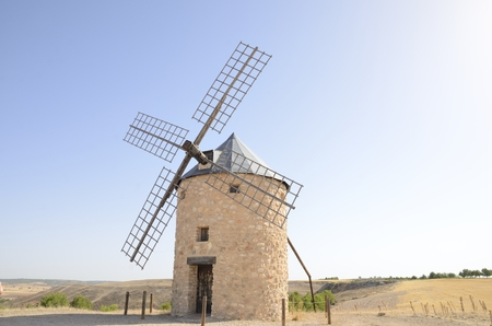 mancha: Stone windmill  in the countryside of Belmonte, a village of the province of Cuenca, Castile-La Mancha, Spain. Stock Photo