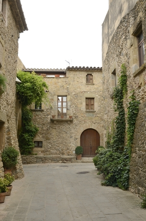 Cobblestone street in the medieval village of Monells, Girona, Catalonia, Spain. Stock Photo