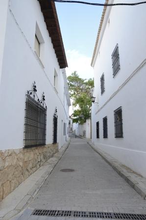 Narrow white street in Belmonte, a village located in the province of Cuenca, Castile-La Mancha, Spain.