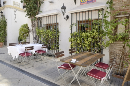 Tables at exterior of restaurant in the old town of Marbella, Malaga, Andalusia, Spain. Editorial