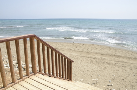 Wooden stairs down to  the beach in Marbella, Andalusia, Spain. Stock Photo