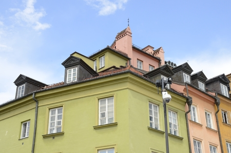 Colorful houses on corner  at the Castle Square  in Warsaw, Poland.