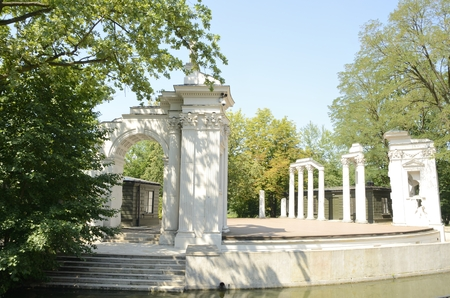 Classical amphitheater on the bank of the Lazienki lake at  park located in the city center of Warsaw, Poland.