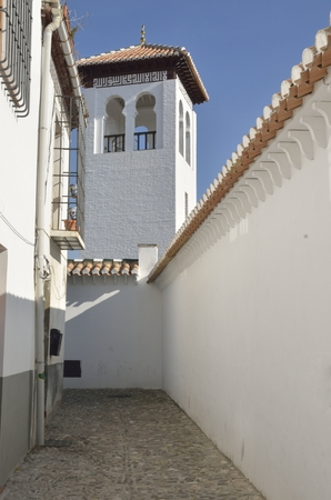 Tower of Great Mosque in the medieval moorish district of Albaicin in Granada, Andalusia, Spain.