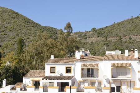 White houses at the hill of  Benahavis, a  mountain village next to Marbella, Andalusia, Spain.