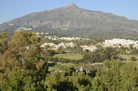 Sight of golf courses and houses at the foot of the mountain in Marbella, Andalusia, Spain. Stock Photo