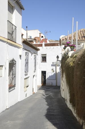 Sloped alley in Benahavis, a  mountain village next to Marbella, Andalusia, Spain.