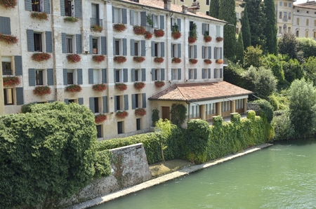 Building at the riverbank of the river Brenta in the city of  Bassano del Grappa, northern Italy.