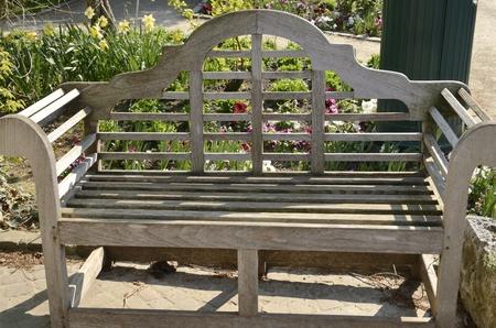 Lonely wooden bench at garden in Leuven, Belgium.  Stockfoto