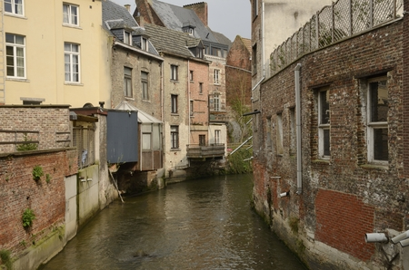 Buildings  along river canal in the old town of  Leuven, Belgium.