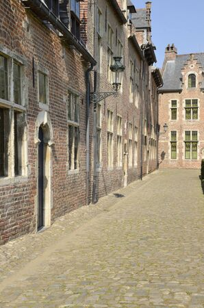 Cobbled narrow street of the Great  Beguinage in Leuven, the capital of the province of Flemish Brabant in Belgium.
