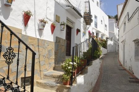 Picturesque whitewashed alley in Casares, a  mountain village of Malaga province, Andalusia, Spain.