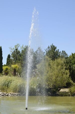 Stream of water in pond at park located in Madrid, the capital of Spain.