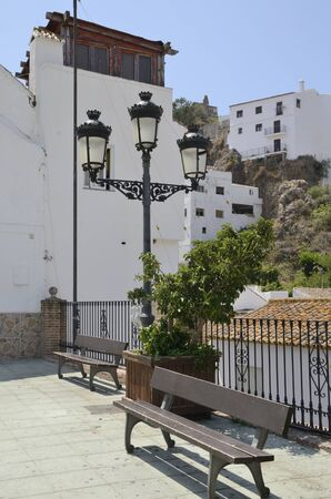 Benches at square  in Casares, a  mountain village of Malaga province, Andalusia, Spain. Stock fotó