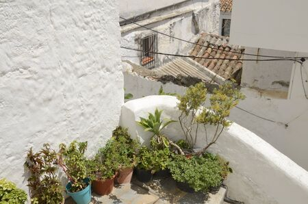 Pots on terrace in Casares, a mountain village of Malaga province, Andalusia, Spain.