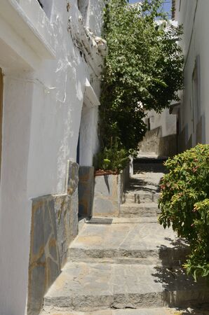 Stone stairs at alley landscaped  in Casares, a mountain village of Malaga province, Andalusia, Spain. Stock fotó
