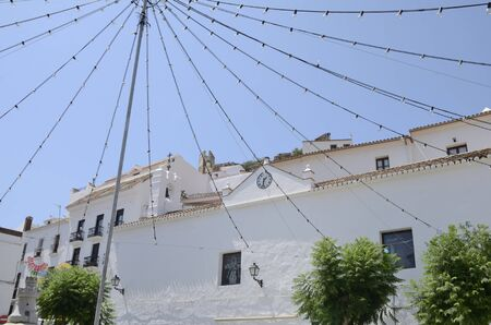Light bulbs and white buildings in Casares, a mountain village of Malaga province, Andalusia, Spain.