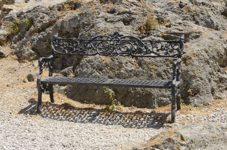 Black iron bench at rural ladscape in Casares, a village of Malaga province, Andalusia, Spain.