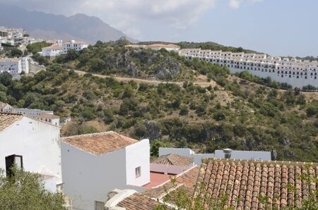 White houses at the range in Casares, a village of Malaga province, Andalusia, Spain.
