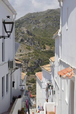 Clothes hanging at exterior in narrow white alley of Casares, a mountain village of Malaga province, Andalusia, Spain. 版權商用圖片