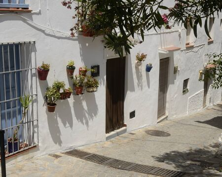 Whitewashed alley in Casares, a  mountain village of Malaga province, Andalusia, Spain. Stock fotó