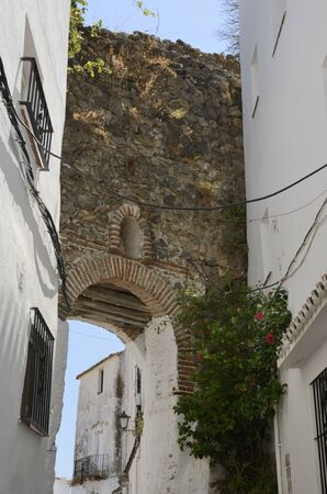Stone archway in Casares, a  mountain village of Malaga province, Andalusia, Spain.