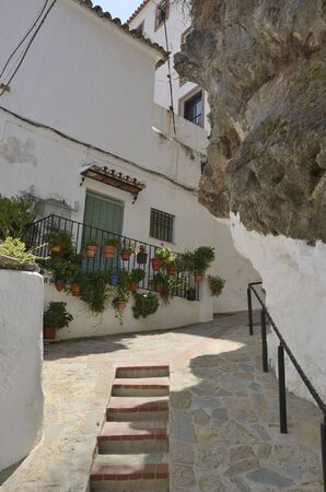 Big rock at stepped footpath in Casares, a mountain white village of Malaga province, Andalusia, Spain.